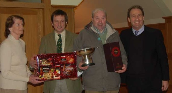 Davy Leith receives his prizes from Ian Millar and Marjory Walker