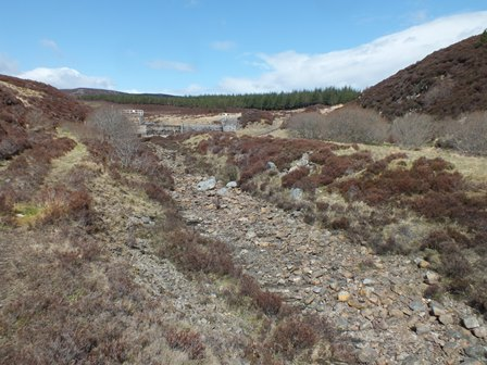 The dry riverbed of the Sluie below the dam