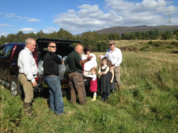 Left to Right: Ghillie Jim Lowe, SFB Head Bailiff Richard Whyte, Hatchery Manager Jimmy Woods & Mr and Mrs Guy Macpherson Grant & family.