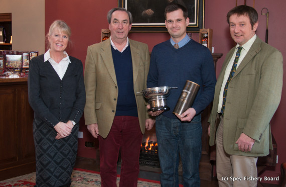 Ballindalloch Gillie Steve Brand with prize and trophy. Accompanied by Chairman, Brian Doran, Director Roger Knight and Administrator Sally Gross.
