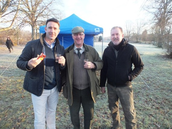 River Spey Anglers Association Chairperson Craig Mackay on the left, and other members enjoying the traditional opening day diet of whisky and shortbread
