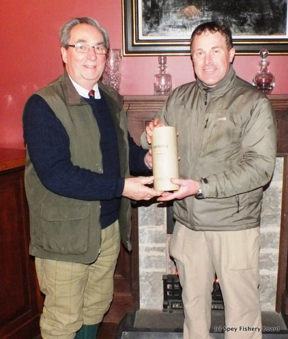 Graham Ritchie receiving a bottle of Aberlour from the Chairman